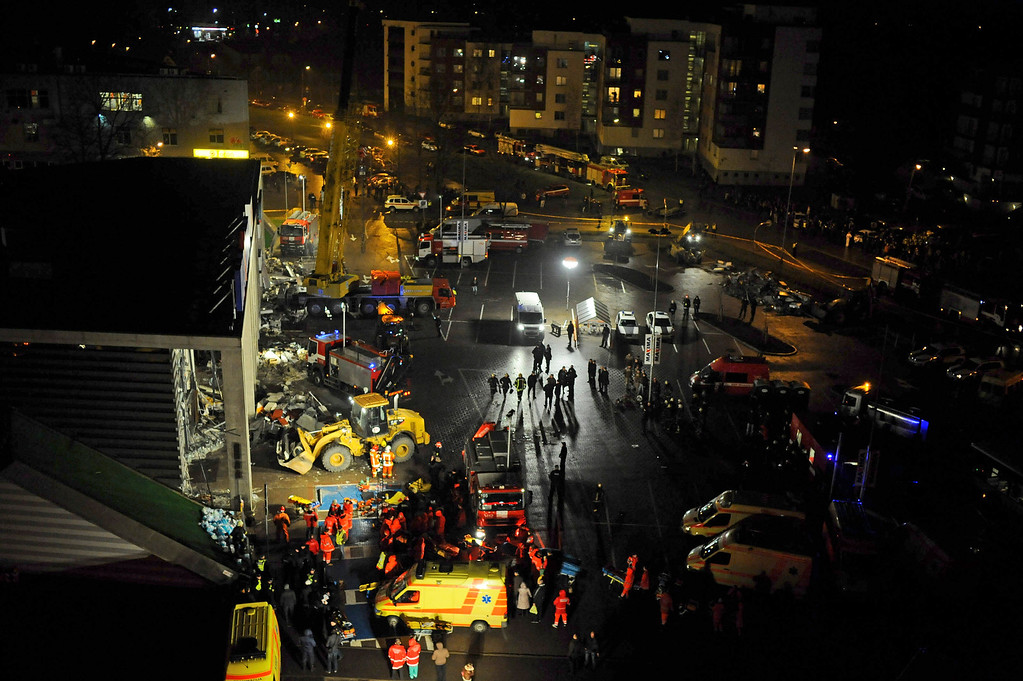 . A  late Thursday, Nov. 21, 2013 view of a rescue operation outside collapsed Maxima supermarket in Riga, Latvia. (AP Photo/ Maris Morkans)