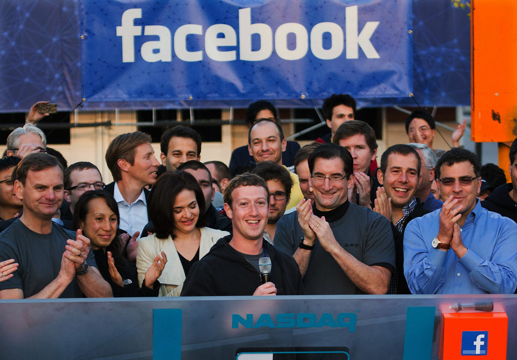 . In this May 18, 2012 file photo provided by Facebook, Facebook founder, Chairman and CEO Mark Zuckerberg, center, rings the Nasdaq opening bell from Facebook headquarters in Menlo Park, Calif. Robert Greifeld, second from right, CEO of the Nasdaq-OMX Stock Market, Inc. The social media company had its IPO. (AP Photo/Nasdaq via Facebook, Zef Nikolla, File)