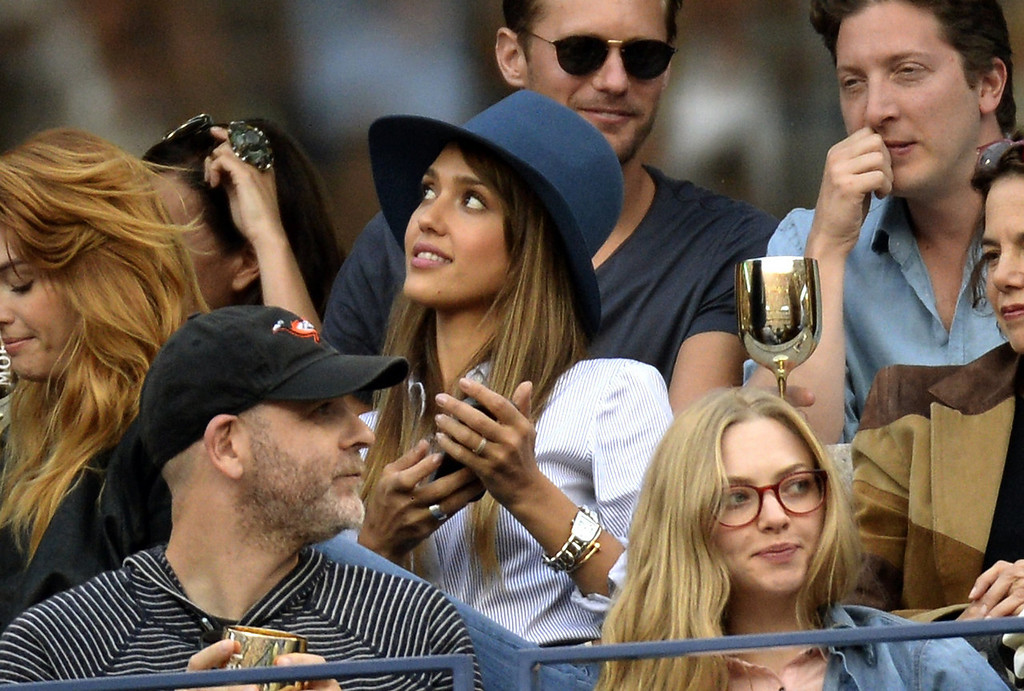 . Jessica Alba watches Novak Djokovic of Serbia against  Rafael Nadal of Spain during their 2013 US Open men\'s singles final  match at the USTA Billie Jean King National Tennis Center in New York on September 9, 2013.   TIMOTHY CLARY/AFP/Getty Images