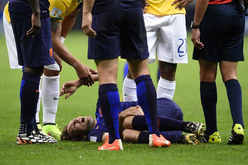 . Netherlands\' defender Daley Blind reacts on the ground during the third place play-off football match between Brazil and Netherlands during the 2014 FIFA World Cup at the National Stadium in Brasilia on July 12, 2014.(FABRICE COFFRINI/AFP/Getty Images)