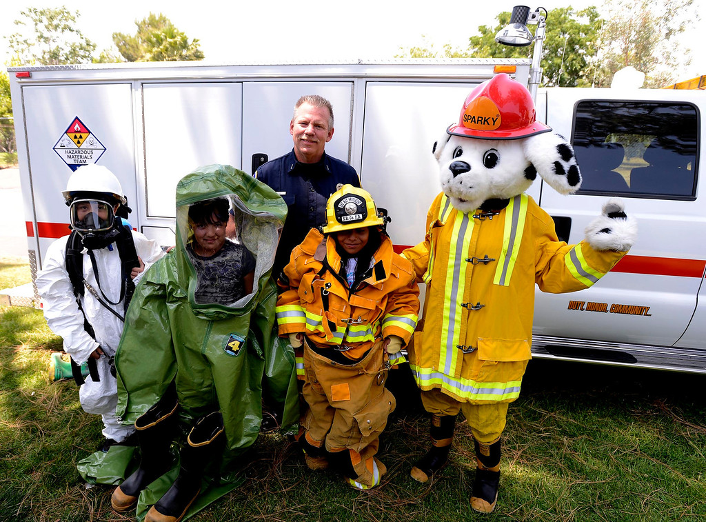 . Brian Otter of San Bernardino County Fire/ Hazardous Material,center,  poses with students and mascot Sparky during the final day of the 19th Annual Career Awareness Week at Lankershim Elementary School in Highland June 6, 2013.  GABRIEL LUIS ACOSTA/STAFF PHOTOGRAPHER.