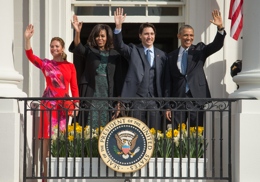 . President Barack Obama and first lady Michelle Obama wave with Canadian Prime Minister Justin Trudeau, and his wife Sophie Gregoire, on the Truman Balcony during an arrival ceremony on the South Lawn of the White House in Washington, Thursday, March 10, 2016. (AP Photo/Andrew Harnik)
