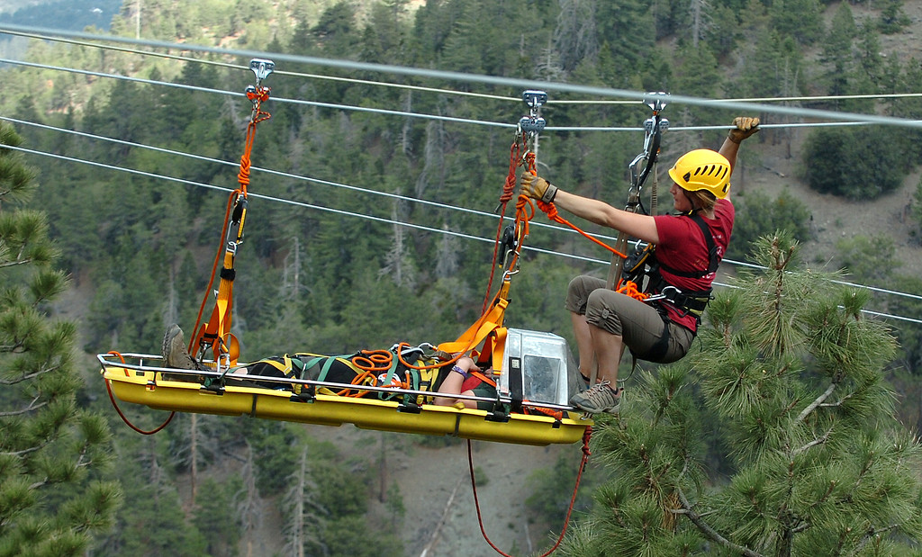 . Navitat Canopy Adventures Course Manager Mary Audrey Gilkison, 25 of Long Beach, trains in a zip line rescue along with the San Bernardino and Los Angeles county fire depts while doing zip line and helicopter hoist rescues in Wrightwood May 13, 2013. The training will help when hikers get lost or injured and need to be rescued.  (Thomas R. Cordova/Staff Photographer)