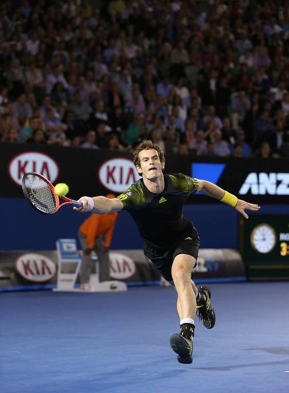 . Britain\'s Andy Murray reaches for a return to Switzerland\'s Roger Federer during their semifinal match at the Australian Open tennis championship in Melbourne, Australia, Friday, Jan. 25, 2013. (AP Photo/Greg Baker)