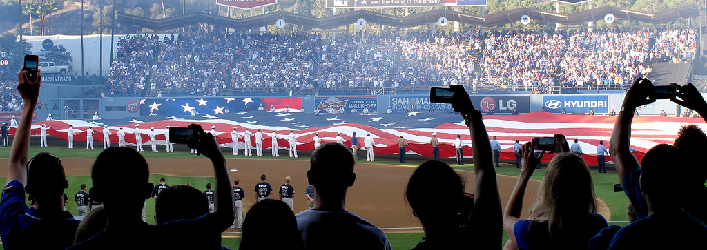 . Los Angeles Dodger fans use their cell phones to record pre-game flag presentation at game 3 of the NLDS against the Atlanta Braves on Sunday, October 6, 2013.  (Photo by Dean Musgrove/Los Angeles Daily News)