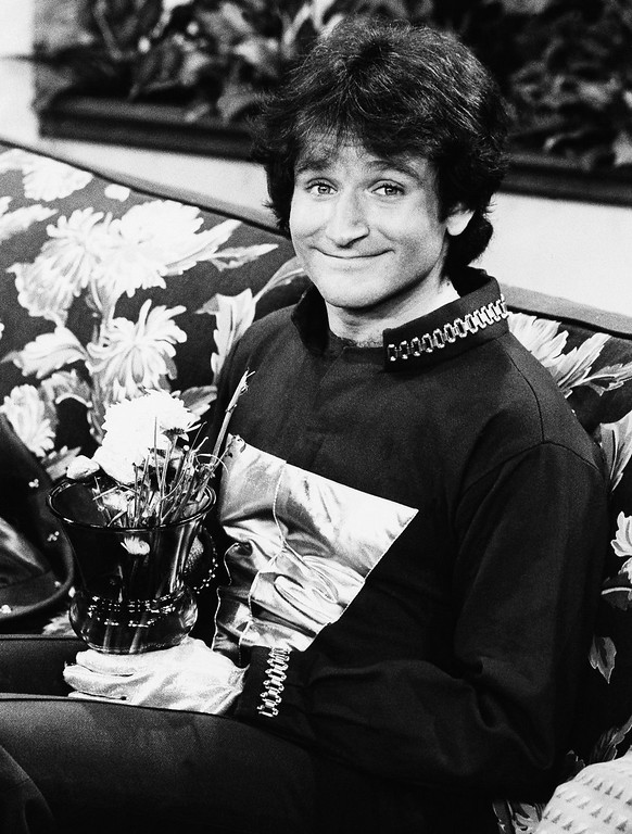 ". Robin Williams on the set of ABCs ""Mork and Mindy\"" in 1978. Williams, whose free-form comedy and adept impressions dazzled audiences for decades, has died in an apparent suicide. He was 63. The Marin County Sheriff\'s Office said Williams was pronounced dead at his home in California on Monday, Aug. 11, 2014. The sheriff\'s office said a preliminary investigation showed the cause of death to be a suicide due to asphyxia. (AP Photo/ABC, File)"