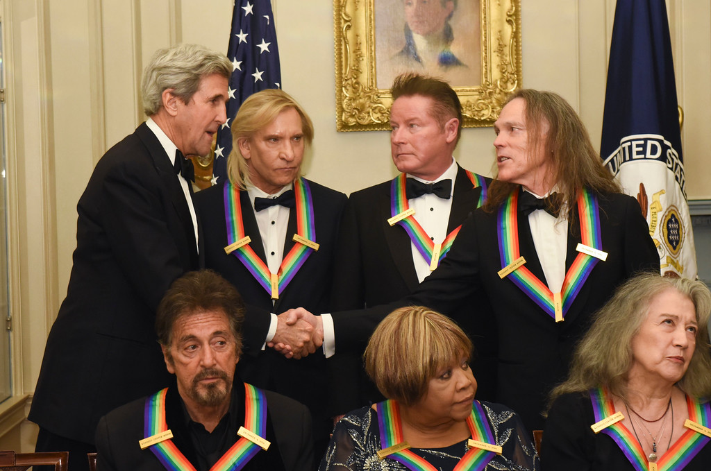 . Secretary of State John Kerry, top left, meets with Eagles members Tim Schmit, right, Don Henley, second right, and Joe Walsh, second left, all 2016 Kennedy Center Honorees following the State Department for the Kennedy Center Honors gala dinner, Saturday, Dec. 3, 2016, in Washington. Also photographed are honorees, front row from left, Al Pacino, Mavis Staples and Martha Argerich. (AP Photo/Kevin Wolf)