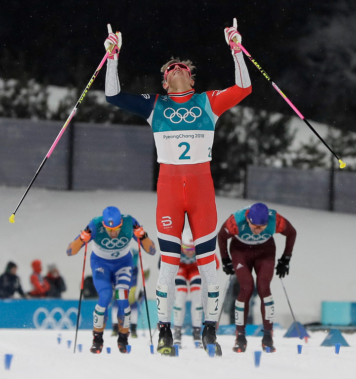 . Johannes Hoesflot Klaebo, of Norway, celebrates after winning the men\'s cross-country skiing sprint classic at the 2018 Winter Olympics in Pyeongchang, South Korea, Tuesday, Feb. 13, 2018. (AP Photo/Kirsty Wigglesworth)