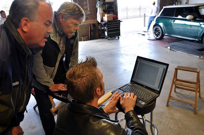 Mike, Dennis and David (l to r) take a look a Mike's results from their own OBDII recordings during their dyno runs.
