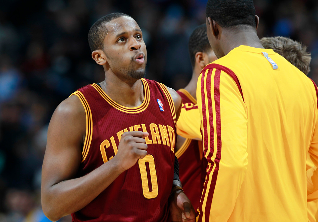 . Cleveland Cavaliers guard C.J. Miles reacts as he heads to a timeout with only seconds remaining in the fourth quarter in an NBA basketball game against the Denver Nuggets in Denver, Friday, Jan. 17, 2014. The Cavaliers won 117-109. (AP Photo/David Zalubowski)
