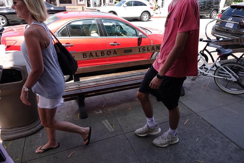 Walking by a Balboa Island bench