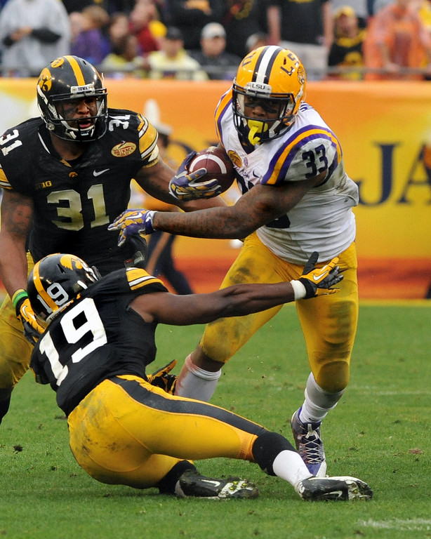 . Running back Jeremy Hill #33 of the LSU Tigers rushes upfield against the Iowa Hawkeyes January 1, 2014  in the Outback Bowl at Raymond James Stadium in Tampa, Florida.  Hill ran for a touchdown in the first half. (Photo by Al Messerschmidt/Getty Images)