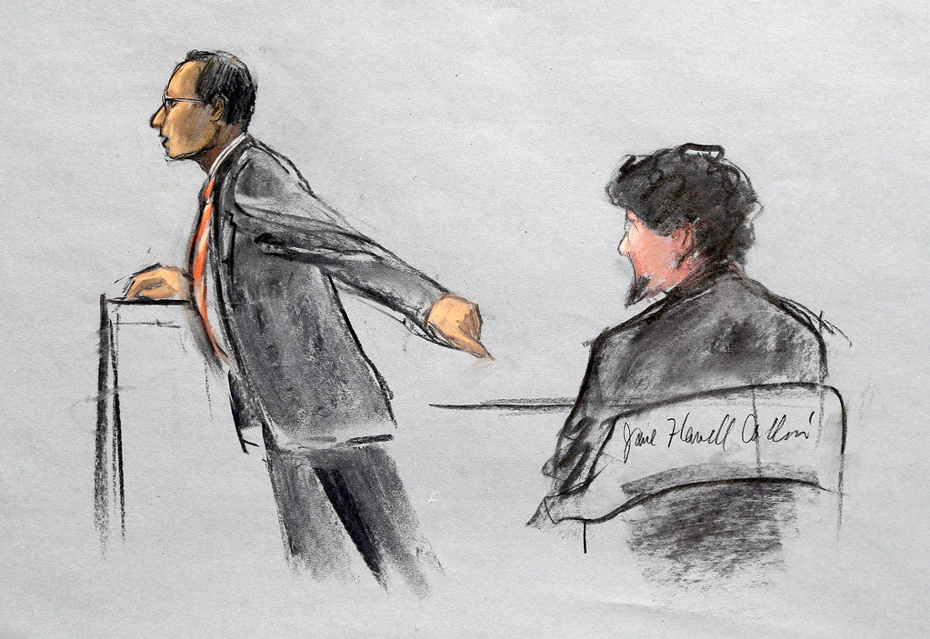 . In this courtroom sketch, Assistant U.S. Attorney Aloke Chakravarty is depicted pointing to defendant Dzhokhar Tsarnaev, right, during closing arguments in Tsarnaev\'s federal death penalty trial Monday, April 6, 2015, in Boston. Tsarnaev is charged with conspiring with his brother to place two bombs near the Boston Marathon finish line in April 2013, killing three and injuring 260 people. (AP Photo/Jane Flavell Collins)