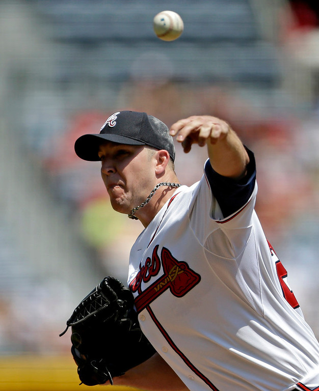. Atlanta starting pitcher Paul Maholm throws in the first inning against the Twins. Maholm allowed one earned run on seven hits over 7-1/3 innings to get the win. (AP Photo/David Goldman)