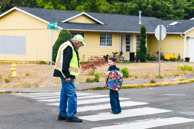 School crossing guard Bill Jendraszek speaks to a young student. Jendraszek has been a crossing guard since 2013. Back to school day at Hallman Elementary School on Wednesday, September 4, 2019 in Salem, Ore.