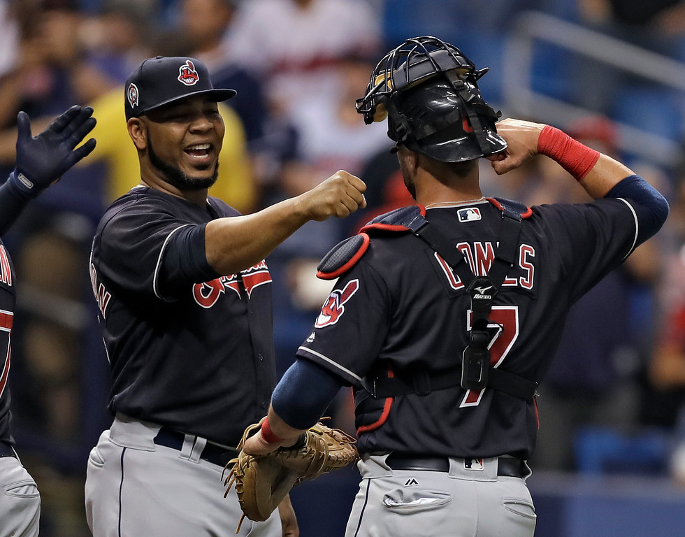 . Cleveland Indians\' Edwin Encarnacion, left, and catcher Yan Gomes celebrate after the team defeated the Tampa Bay Rays 2-0 during a baseball game, Tuesday, Sept. 11, 2018, in St. Petersburg, Fla. (AP Photo/Chris O\'Meara)