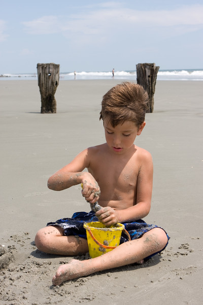 Connor getting serious about this sand castle.jpg