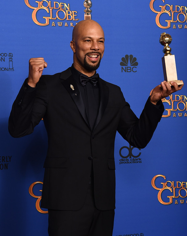 . Common poses in the press room with the award for best original song ìGloryî in a film for ìSelmaî at the 72nd annual Golden Globe Awards at the Beverly Hilton Hotel on Sunday, Jan. 11, 2015, in Beverly Hills, Calif. (Photo by Jordan Strauss/Invision/AP)