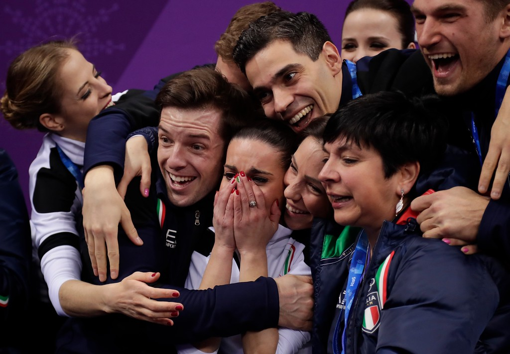 . Valentina Marchei and Ondrej Hotarek of Italy react with their teammates to their scores after performing in the team event pair skating in the Gangneung Ice Arena at the 2018 Winter Olympics in Gangneung, South Korea, Sunday, Feb. 11, 2018. (AP Photo/Julie Jacobson)