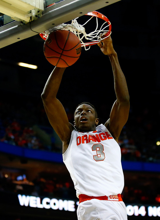 . BUFFALO, NY - MARCH 20: Jerami Grant #3 of the Syracuse Orange dunks against the Western Michigan Broncos during the second round of the 2014 NCAA Men\'s Basketball Tournament at the First Niagara Center on March 20, 2014 in Buffalo, New York.  (Photo by Jared Wickerham/Getty Images)