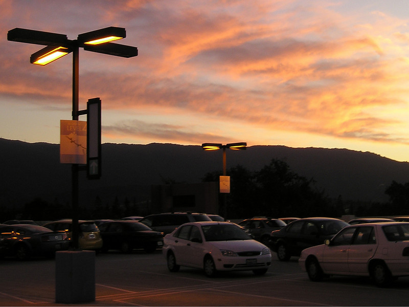 Can't help it, I just loved the shape and glow of the parking lot lights with the sunset clouds and the cars just reflecting the colors. (From top level of Oakridge Shopping Center parking garage.)