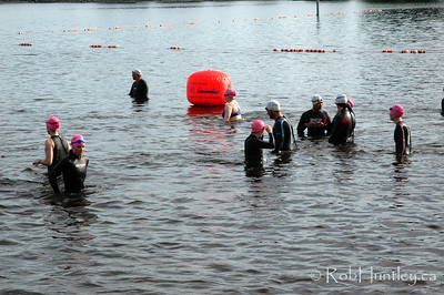 2009 Ottawa Riverkeeper Triathlon. Swimmers in the background acclimatizing to the water in anticipation of their upcoming event.  © Rob Huntley
