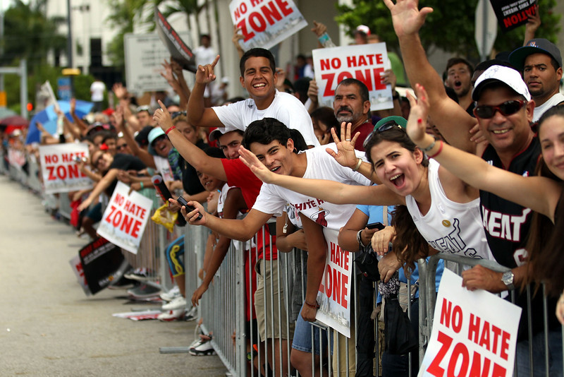 . Fans cheer as members of the Miami Heat ride in the NBA championship victory parade on June 24, 2013 in Miami, Florida. The Miami Heat defeated the San Antonio Spurs in the NBA Finals. (Photo by Marc Serota/Getty Images)