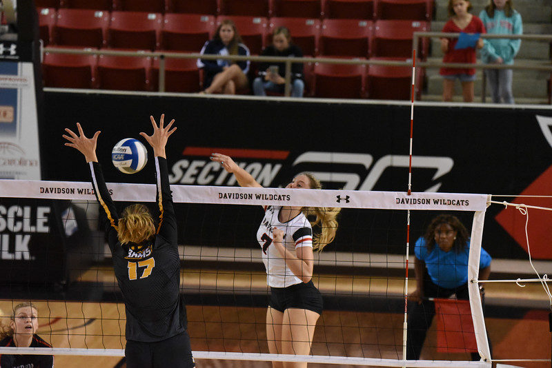 Davidson freshman Hattie Rodriguez goes for a kill against the VCU Rams. VCU defeated the 'Cats in the Saturday evening matchup.