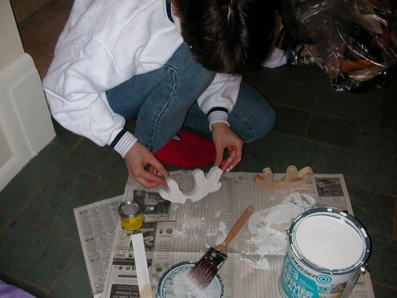 Karen doing some of the painting after the pieces are cut out.