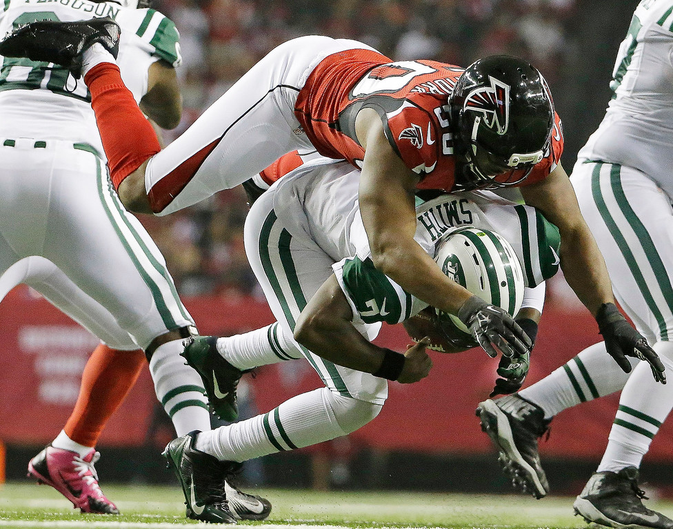 . New York Jets quarterback Geno Smith (7) is sacked by Atlanta Falcons defensive end Osi Umenyiora (50) during the second half of an NFL football game, Monday, Oct. 7, 2013, in Atlanta. (AP Photo/David Goldman)