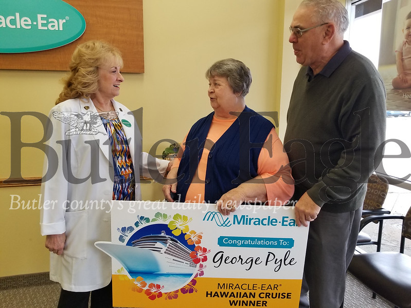 Marleen Hoffmann, audioprosthologist at the Butler Miracle Ear in Moraine Pointe Plaza, congratulated her longtime patient and his wife, George and Carol Pyle of Franklin Township, for winning a luxury Hawaiian cruise. More than 16,000 patients across the U.S. entered the sweepstakes. The couple was surprised with the cruise news at George's Wednesday morning appointment.
