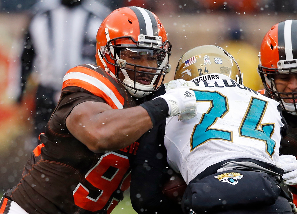 . Cleveland Browns defensive end Myles Garrett, left, tackles Jacksonville Jaguars running back T.J. Yeldon in the first half of an NFL football game, Sunday, Nov. 19, 2017, in Cleveland. (AP Photo/Ron Schwane)