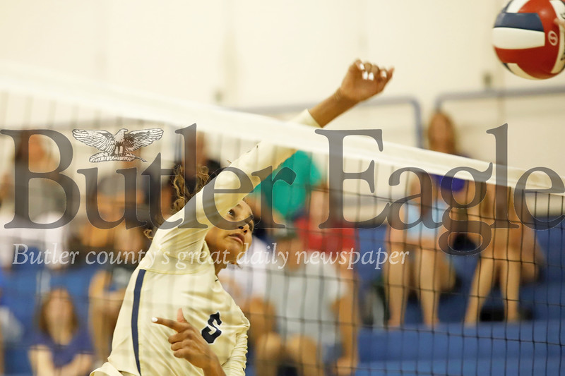 Ava Carney of Butler goes for a spike over Mars Monday. The Golden Tornado topped the Planets 3-1. Seb Foltz/Butler Eagle