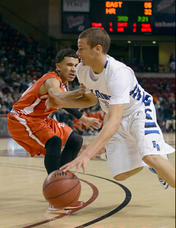 . DENVER, CO. - FEBRUARY 09: Evan Motlong (3) of Highlands Ranch drives on Brian Carey (11) of East February 9, 2012 at Magness Arena.  East defeated Highlands Ranch 73 - 54. (Photo By John Leyba/The Denver Post)