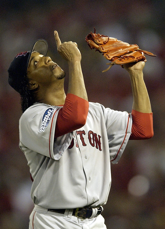 . Boston Red Sox pitcher Pedro Martinez points to the sky as he walks off the field after retiring the St. Louis Cardinals in the seventh inning of Game 3 of the World Series Tuesday, Oct. 26, 2004, in St. Louis. (AP Photo/Charles Rex Arbogast)