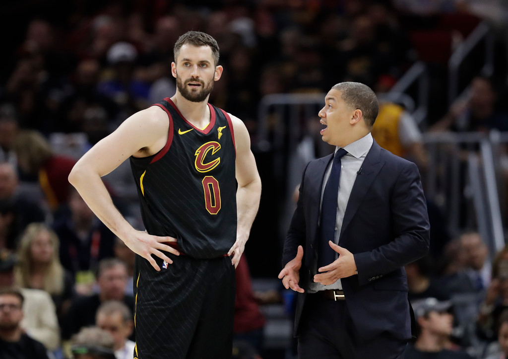 . Cleveland Cavaliers\' Tyronn Lue talks with Kevin Love in the second half of Game 4 of basketball\'s NBA Finals against the Golden State Warriors, Friday, June 8, 2018, in Cleveland. (AP Photo/Tony Dejak)