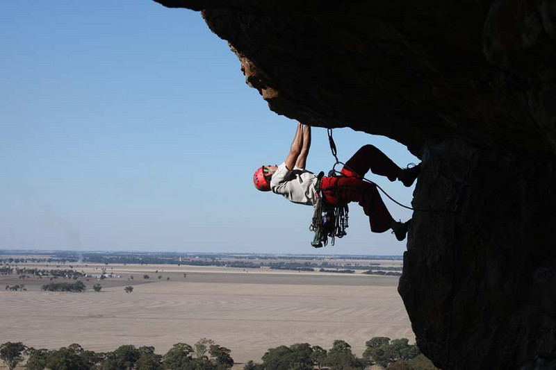 Trent posing on Pilot Error, while desperately looking for any holds. Mt. Arapiles, Victoria, Australia. Photography by Marikki Patrikka.