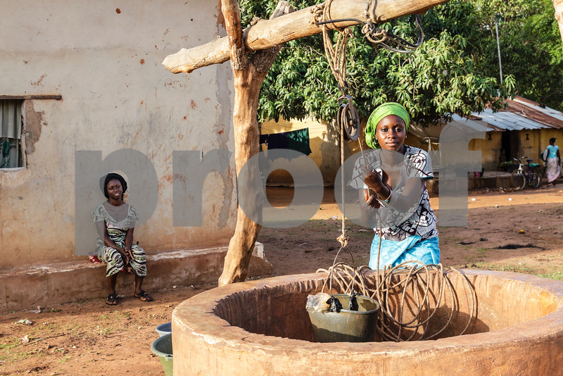 Istock photo of women outside a well in Africa