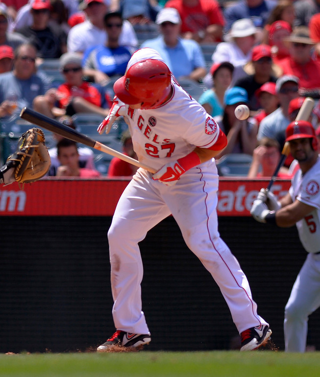 . Los Angeles Angels\' Mike Trout is hit by a pitch during the sixth inning of their baseball game against the Pittsburgh Pirates, Sunday, June 23, 2013, in Anaheim, Calif.  (AP Photo/Mark J. Terrill)