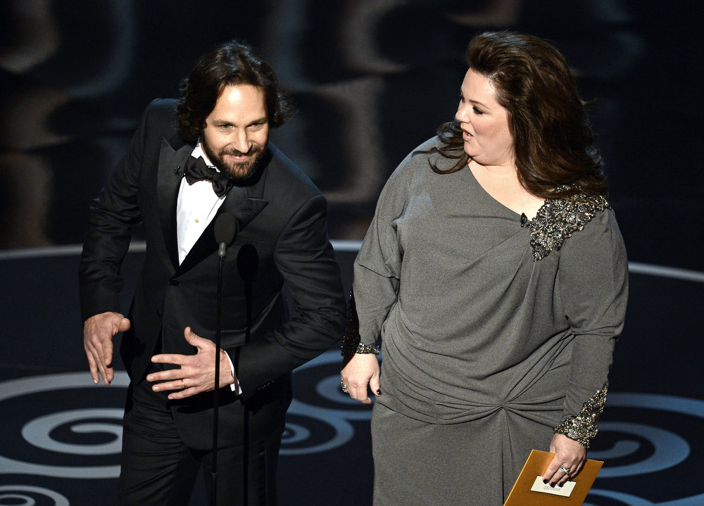 Description of . Actor Paul Rudd and actress Melissa McCarthy present onstage during the Oscars held at the Dolby Theatre on February 24, 2013 in Hollywood, California.  (Photo by Kevin Winter/Getty Images)