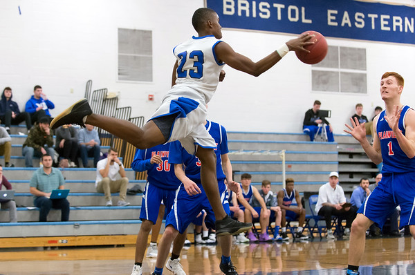 01/07/19 Wesley Bunnell | Staff Bristol Eastern boys basketball in a home game vs Plainvillle on Monday night. Brendon Gayle (23) prepares to throw the ball off of Sam Lestini (1) to keep possession.