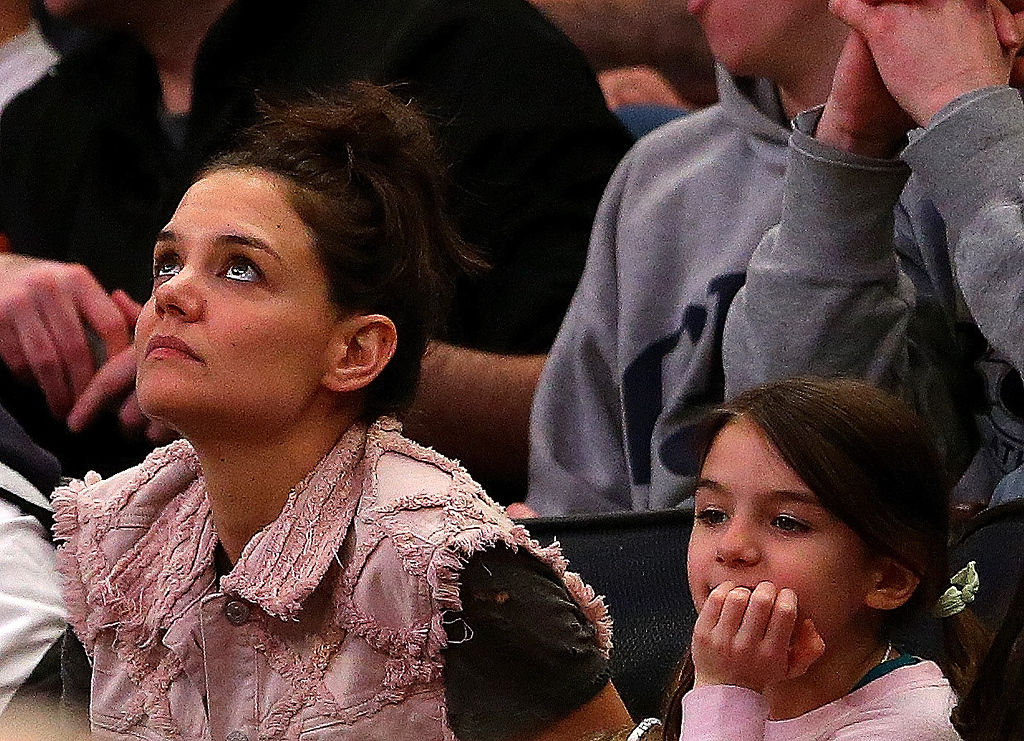 . Actress Katie Holmes and her daughter Suri Cruise attend the East Regional Final of the 2014 NCAA Men\'s Basketball Tournament between the Connecticut Huskies and the Michigan State Spartans at Madison Square Garden on March 30, 2014 in New York City.  (Photo by Elsa/Getty Images)
