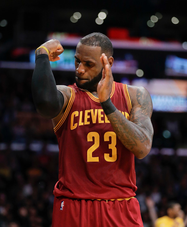 . Cleveland Cavaliers\' LeBron James flexes his arm after making a basket and drawing a foul call against the Los Angeles Lakers during the second half of an NBA basketball game Sunday, March 19, 2017, in Los Angeles. The Cavaliers won 125-120. (AP Photo/Jae C. Hong)