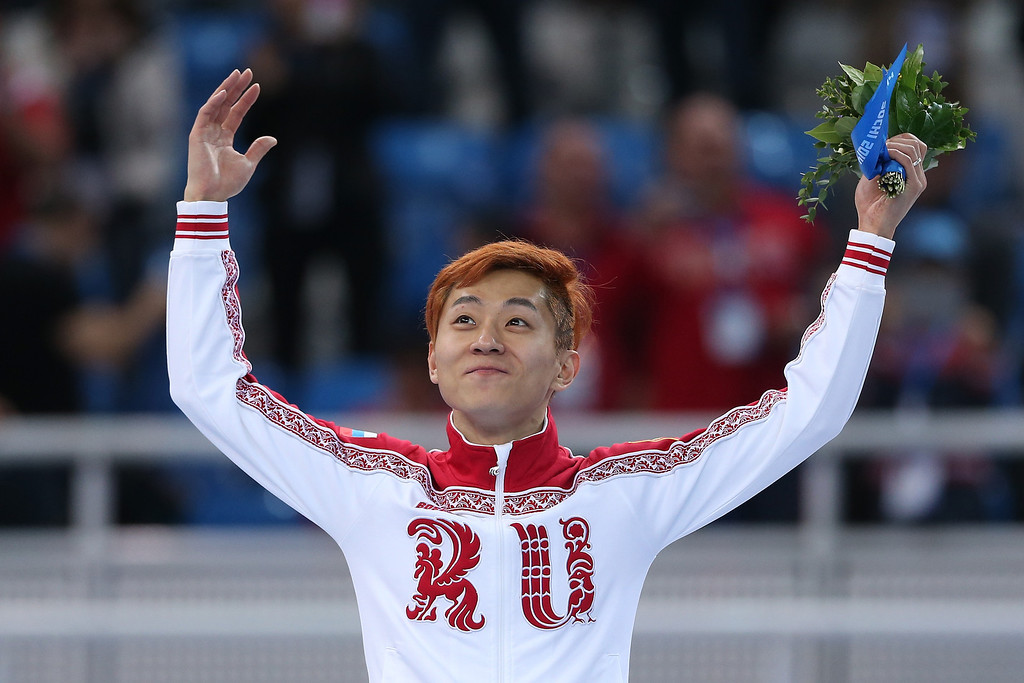 . SOCHI, RUSSIA - FEBRUARY 15:  Gold medallist Victor An of Russia stands on the podium during the flower ceremony after the Men\'s 1000 m Final Short Track Speed Skating on day 8 of the Sochi 2014 Winter Olympics at the Iceberg Skating Palace on February 15, 2014 in Sochi, Russia.  (Photo by Matthew Stockman/Getty Images)
