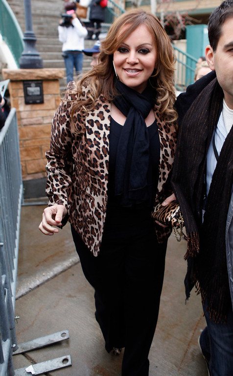 . Singer Jenni Rivera stands on Main Street during the Sundance Film Festival in Park City, Utah in this January 20, 2012 file photo. Mexican-American singer Rivera is missing after the plane she was travel ling in disappeared shortly after leaving the northern Mexican city of Monterrey early on December 9, 2012. Rivera was heading for the city of Toluca in central Mexico after a concert in Monterrey on the night of December 8, 2012. The singer, two pilots and four other passengers are all missing, the ministry said. A search is continuing for the aircraft.    REUTERS/Jim Urquhart/Files
