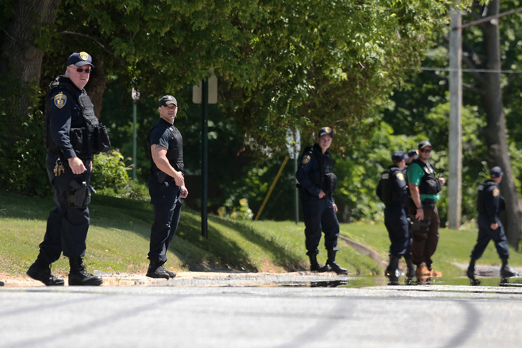 . Law enforcement officers sweep through Smith Street in Dannemora, N.Y. on Saturday, June 6, 2015 during a search for escaped prisoners. Two convicted murderers used power tools to cut through steel pipes at a maximum-security prison near the Canadian border and escape through a manhole, Gov. Andrew Cuomo said Saturday. (Gabe Dickens/Press-Republican via AP)