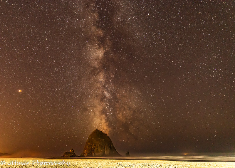 Haystack Rock on Cannon Beach with Milky Way behind it
