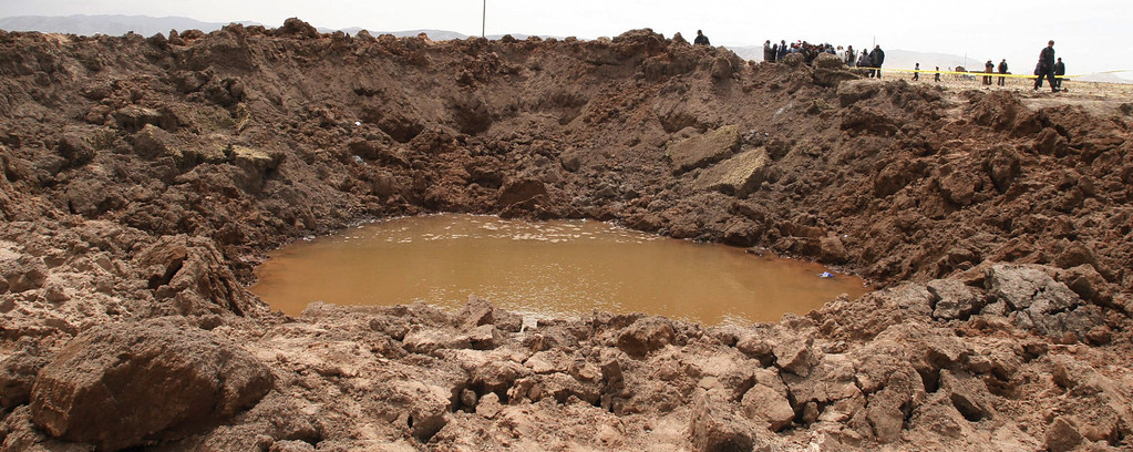 . A crater is seen in Carangas, Puno, Peru, Monday, Sept. 17, 2007, caused by a supposed meteorite that crashed in southern Peru over the weekend causing hundreds of people to suffer headaches, nausea and respiratory problems, a health official said Tuesday, Sept. 18, 2007. (AP Photo/La Razon, Miguel Carrasco)
