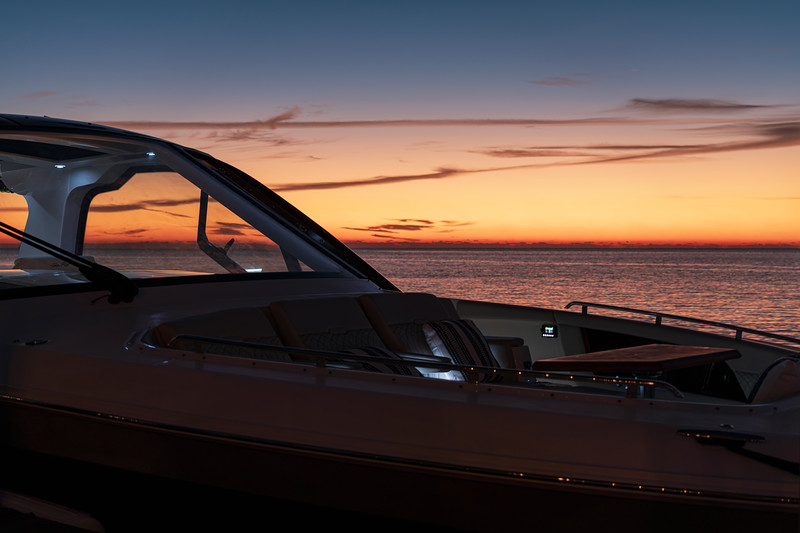 2021-Sundancer-370-Outboard-DAO370-bow-seating-table-accent-lighting-twilight-05832.jpg