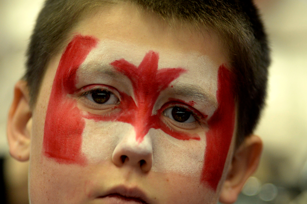 . A young fan wears team Canada paint during the first period of the women\'s gold medal ice hockey game. Sochi 2014 Winter Olympics on Thursday, February 20, 2014 at Bolshoy Ice Arena. (Photo by AAron Ontiveroz/ The Denver Post)